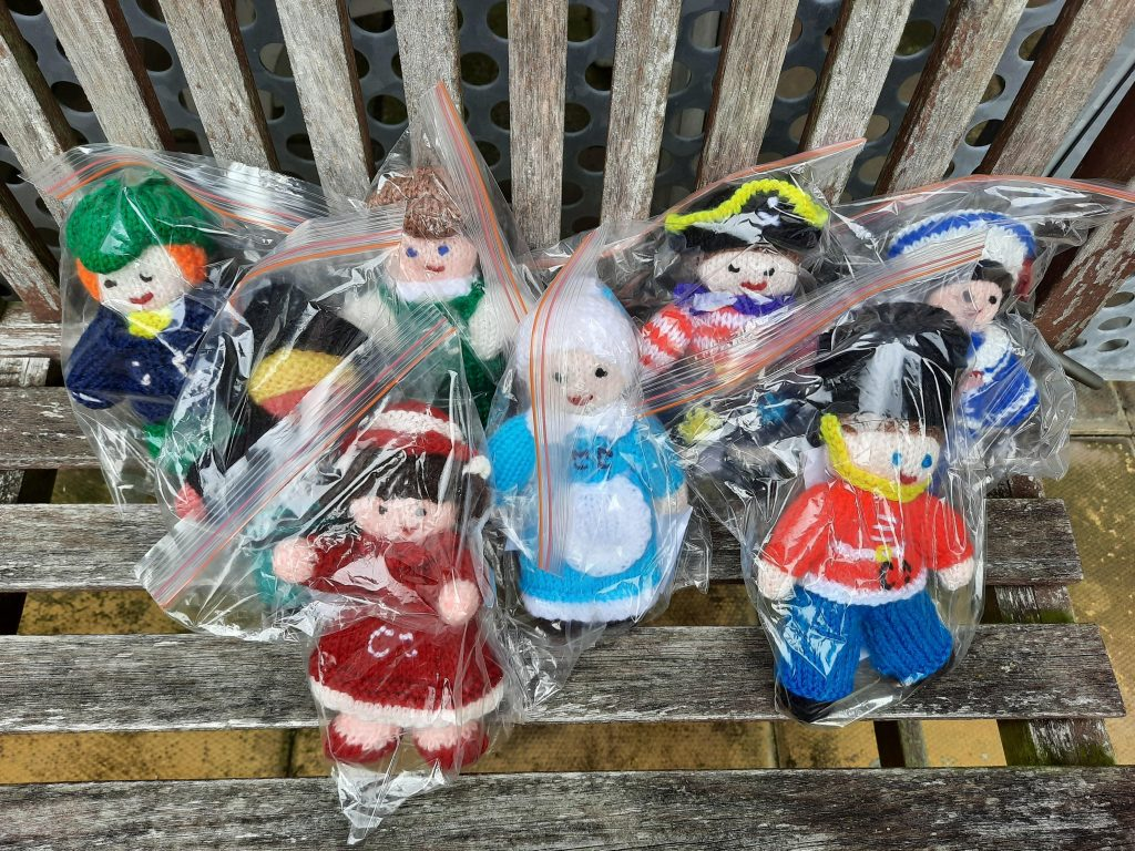 knitted mascots sealed in bags